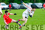 St. Pat's Brendan Poff gets away from Waterville's Micheal Curran  at the Credit Union Senior Football League Div.2 Round 5 St. Pat's Blennerville V Waterville at the Blennerville GAA Ground on Saturday