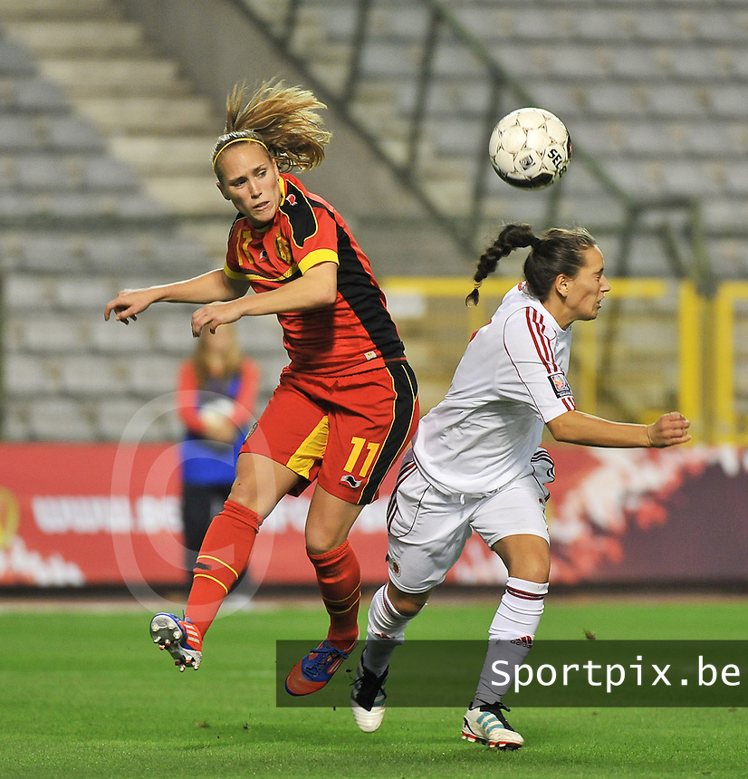 20130921 - BRUSSELS , BELGIUM : Belgian Janice Cayman (left) pictured in a header with Albanian Lulaj Cyme (right) during the female soccer match between Belgium and Albania , on the first matchday in group 5 of the UEFA qualifying round to the FIFA Women World Cup in Canada 2015 at the Koning Boudewijn Stadion , Brussels . Saturday 21th September 2013. PHOTO DAVID CATRY