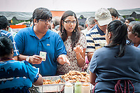 Indian-Americans purchase food from the street fair at the end of the Indian Independence Day Parade on Madison Ave. on Sunday, August 18, 2013.  Now in it's 33rd year, the parade celebrates the 66th anniversary of India's partition from British rule on August 15, 1947. (© Richard B. Levine)
