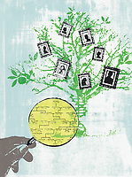 Hand holding magnifying glass studying family tree