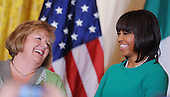 First lady Michelle Obama (R) jokes with Fionnuala Kenny, wife of Prime Minister Enda Kenny of Ireland, during a reception in the East Room on March 19, 2013 in Washington, DC.<br /> Credit: Olivier Douliery / Pool via CNP