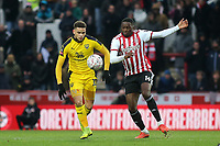 Marcus Browne of Oxford United and Brentford's Josh Ruffels challenge for the ball during Brentford vs Oxford United, Emirates FA Cup Football at Griffin Park on 5th January 2019