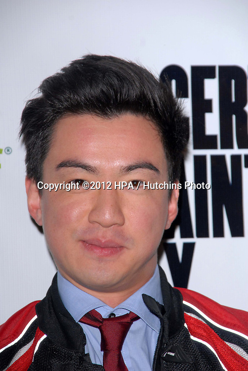 LOS ANGELES - NOV 27:  Johnny M Wu arrives at the 'Certainty' Los Angeles premiere at Laemmle Music Hall on November 27, 2012 in Beverly Hills, CA