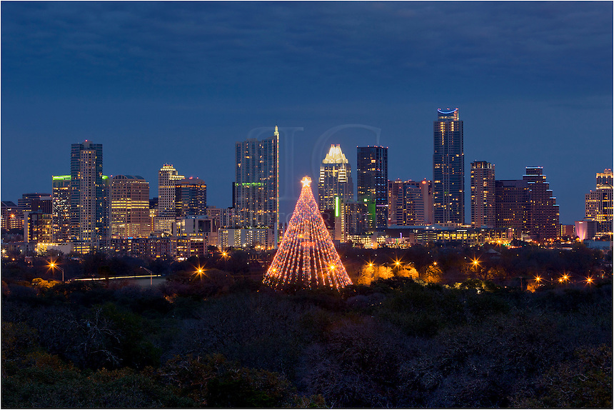 With the Austin skyline in the background, this image shows the annually  lit Austin Christmas - Austin Skyline With The Christmas Tree, Zilker Park Rob Greebon