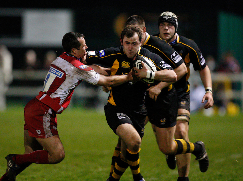 Photo:Richard Lane/Richard Lane Photography. London Wasps A v Gloucester United. Guinness A League. 09/04/2009. Wasps' James Honeyben is tackled by Gloucester's Gareth Cooper.