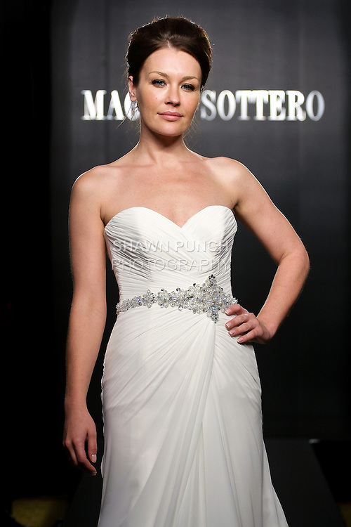 Model walks the runway in a Courtney Couture wedding dress from the Maggie Sottero Bridal Spring 2012 collection, during  Couture: New York Bridal Fashion Week 2012