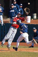 First baseman Kevin Scholly #3 of the Shippensburg Red Raiders has to come off the bag to field a throw as Corey Parker #4 of the Catawba Indians hustles towards first base on February 14, 2010 in Salisbury, North Carolina.  Photo by Brian Westerholt / Four Seam Images