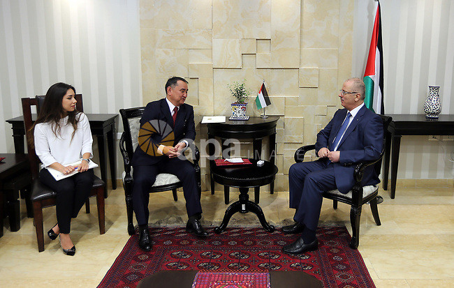Palestinian Prime Minister Rami Hamdallah meets with deputy Minister of Foreign Affairs of Kazakhstan Akylbek Kamaldinov, at his office, in the West Bank city of Ramallah, on July 08, 2017. Photo by Prime Minister Office