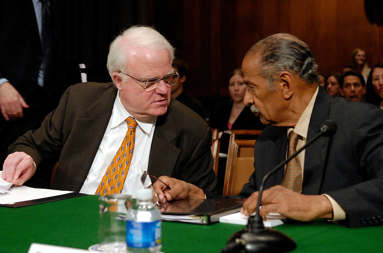 "Rep. James Sensenbrenner Jr., R-Wi., and Rep. John Conyers, Jr., D-Mi., speak before testimony at a Senate Judiciary Committee committee hearing on ""Renewing the Temporary Provisions of the Voting Rights Act: An Introduction to the Evidence.""."