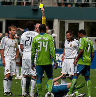 Alan Gordon of the LA Galaxy gets a yellow card after a collision with Freddie Ljungberg at Quest Field on May 10, 2009. The Sounders and Galaxy played to a 1-1 draw.
