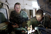 First Lieutenant Jennifer Wynn 24 years old from from Kennett Square Pennsylvania , Battalion maintenance officer of 1st Battalion, 506th, 101st airborne Division supervises on truck repairs at Combat Outpost (C.O.P)  in Eastern Ramadi, Al Anbar Province, Iraq on Wednesday JAN 11 2006. she has been in the military since MAY 2004. she has not yet decided  if she will  be a career officer in the US   ARMY.
