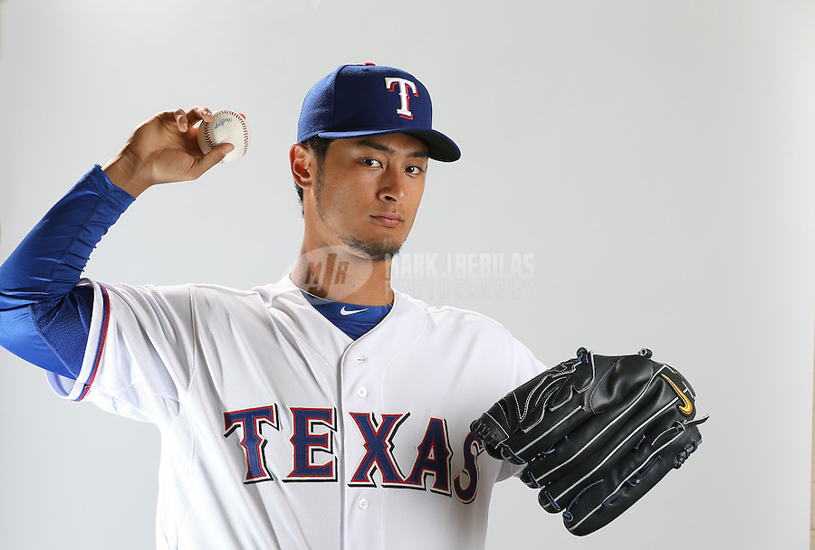 Feb. 20, 2013; Surprise, AZ, USA: Texas Rangers pitcher Yu Darvish poses for a portrait during photo day at Surprise Stadium. Mandatory Credit: Mark J. Rebilas-