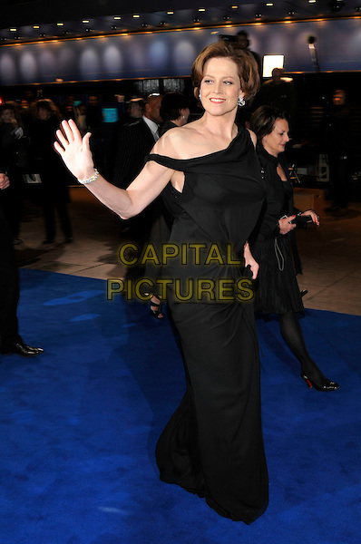"SIGOURNEY WEAVER .Arrivals - World Premiere of ""Avatar"",  Odeon Leicester Square, London, England, UK, December 10th, 2009..full length long maxi black dress off the shoulder hand waving walking .CAP/PL.©Phil Loftus/Capital Pictures."