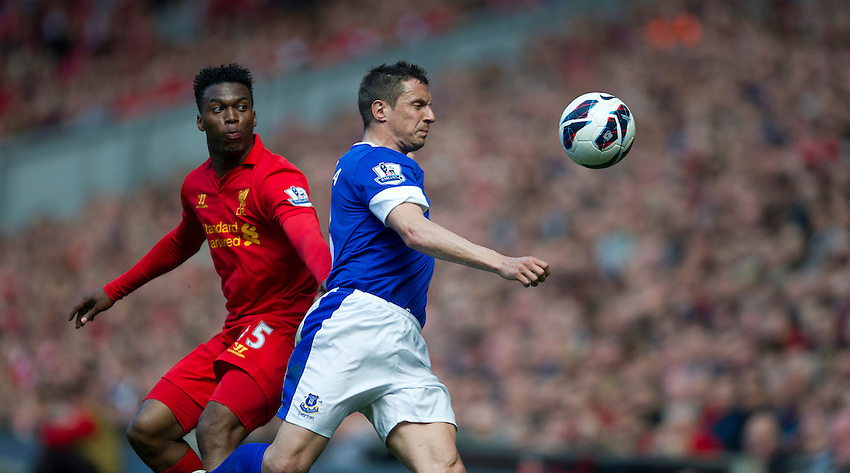Everton's Phil Jagielka watched by Liverpool's Daniel Sturridge .. - (Photo by Stephen White/CameraSport) - ..Football - Barclays Premiership - Liverpool v Everton - Sunday 5th May 2013 - Anfield - Liverpool..© CameraSport - 43 Linden Ave. Countesthorpe. Leicester. England. LE8 5PG - Tel: +44 (0) 116 277 4147 - admin@camerasport.com - www.camerasport.com