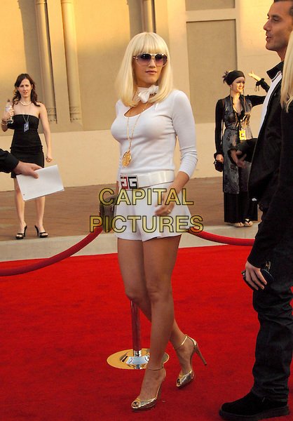 GWEN STEFANI.The 34th Annual American Music Awards held at The Shrine Auditorium in Los Angeles, California, USA. .November 21st, 2006.full length white sjorts top sunglasses shades gold shoes necklace givenchy.CAP/DVS.©Debbie Van Story/Capital Pictures