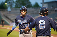 Corpus Christi Hooks designated hitter Granden Goetzman (55) is congratulated by Joshua Rojas (2) following his solo home run Wednesday, May 1, 2019, at Arvest Ballpark in Springdale, Arkansas. (Jason Ivester/Four Seam Images)