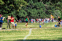 With fans clapping and father Chris cheering and instructing, Ste. Genevieve's Taylor Werner pushes her way up the final 150 meters en route to victory in the 4A Varsity Girls 5k in 17:43 at the 2013 Hancock XC Invitational.