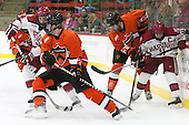Alexander Kerfoot (Harvard - 14), Ben Foster (Princeton - 22), Tommy Davis (Princeton - 25), Kyle Criscuolo (Harvard - 11) - The Harvard University Crimson defeated the visiting Princeton University Tigers 5-0 on Harvard's senior night on Saturday, February 28, 2015, at Bright-Landry Hockey Center in Boston, Massachusetts.