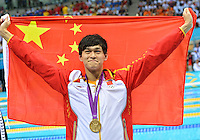 August 04, 2012..Yang Sun looks in the stand while posing for a photograph with Men's 1500m Freestyle Gold Medal at the Aquatics Center on day eight of 2012 Olympic Games in London, United Kingdom.