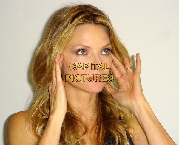 """MICHELLE PFEIFFER .Photocall for """"Stardust"""" at the Four Seasons, California, USA..July 28th, 2007.headshot portrait hands.CAP/AW.©Anita Weber/Capital Pictures"""