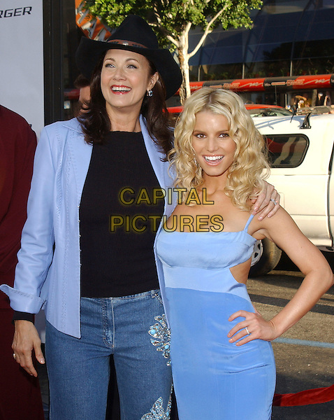 """LYNDA CARTER & JESSICA SIMPSON.The Warner Brothers World Premiere of """"The Dukes of Hazzard"""" held at The Grauman's Chinese Theatre in Hollywood, California  .July 28th, 2005.half length blue dress hand on hip arm over shoulder stetson cowboy hat.www.capitalpictures.com.sales@capitalpictures.com.Supplied By Capital PIctures"""