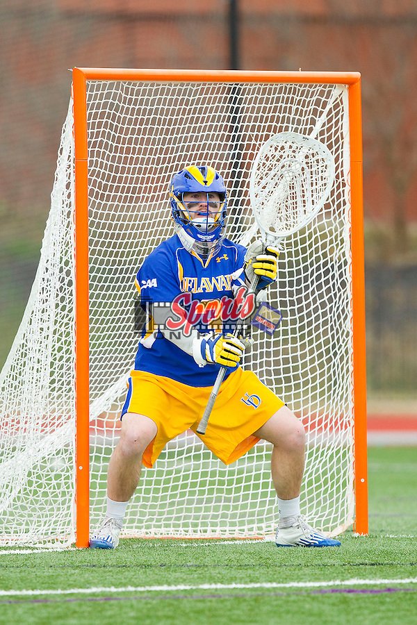 Chris Herbert (3) of the Delaware Blue Hens defends his goal during second half action against the High Point Panthers at Vert Track, Soccer & Lacrosse Stadium on February 2, 2013 in High Point, North Carolina.  The Blue Hens defeated the Panthers 12-10.   (Brian Westerholt/Sports On Film)