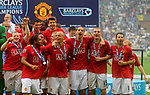 Manchester United celebrate winning the FA Premier League Trophy during the Premier League match at The JJB Stadium, Wigan. Picture date 11th May 2008. Picture credit should read: Simon Bellis/Sportimage