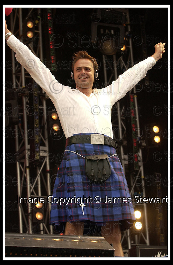 "11/08/2002                   Copyright Pic : James Stewart.File Name : stewart-one big sunday  04.RADIO 1 PRESENTER JAMIE THEAKSTON WEARING HIS KILT TODAY, 11TH AUG 2002, AT THE RADIO 1 ""ONE BIG SUNDAY CONCERT IN FALKIRK.....Payments to :-.James Stewart Photo Agency, 19 Carronlea Drive, Falkirk. FK2 8DN      Vat Reg No. 607 6932 25.Office     : +44 (0)1324 570906     .Mobile  : +44 (0)7721 416997.Fax         :  +44 (0)1324 570906.E-mail  :  jim@jspa.co.uk.If you require further information then contact Jim Stewart on any of the numbers above........."