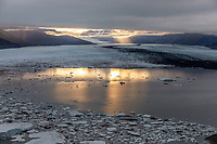 Fall landscape aerial view of Knik Glacier and sun coming through clouds.  Southcentral, Alaska<br /> <br /> Photo by Jeff Schultz/SchultzPhoto.com  (C) 2018  ALL RIGHTS RESERVED<br /> <br /> 2018 Bears, Glaciers and Fall Colors Photo tour/workshop