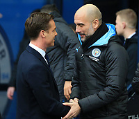 26th January 2020; Etihad Stadium, Manchester, Lancashire, England; English FA Cup Football, Manchester City versus Fulham; Fulham manager Scott Parker shakes hands with Manchester City manager Pep Guardiola
