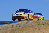 Jun. 21, 2009; Sonoma, CA, USA; NASCAR Sprint Cup Series driver Patrick Carpentier (55) leads Jeff Gordon during the SaveMart 350 at Infineon Raceway. Mandatory Credit: Mark J. Rebilas-