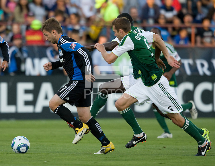 Bobby Convey of Earthquakes controls the ball away from Timbers defenders during the game at Buck Shaw Stadium in Santa Clara, California on August 6th, 2011.   San Jose Earthquakes and Portland Timbers tied 1-1.