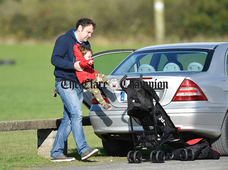 Councillor Cathal Crowe performs his duty as a dad during the Junior A  county final  between Meelick and Kilmurry Ibrickane at Gurteen. Photograph by John Kelly.