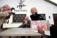 Photographer Liam Mulcahy with Paidi O&quot;Se and Dr. Noelle Campbell-Sharpe at an auction of Liam's pictures in Ventry, County Kerry where all the proceeds went to the Irish Guide Dogs for the Blind. Liam who retired recently as staff photographer withg The Irish Independent donated the pictures which wer auctioned in the pub at the weekend.<br /> Picture by Don MacMonagle