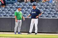 Lexington Legends bench coach Glenn Hubbard (17) and Asheville Tourists development supervisor Randy Ingle (12) before a game at McCormick Field on August 2, 2019 in Asheville, North Carolina. The Tourists defeated the Legends 7-2. (Tony Farlow/Four Seam Images)