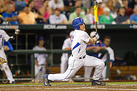 Florida Gators outfielder Harrison Bader (8) follows through on his swing against the Miami Hurricanes in the NCAA College World Series on June 13, 2015 at TD Ameritrade Park in Omaha, Nebraska. Florida defeated Miami 15-3. (Andrew Woolley/Four Seam Images)