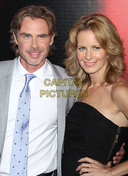 Sam Trammell, Missy Yager<br /> &quot;True Blood&quot; Season 6 Los Angeles Premiere held at The Cinerama Dome, Hollywood, California, USA.<br /> June 11th, 2013<br /> half length suit dress black strapless white shirt purple tie grey gray goatee married husband wife facial hair <br /> CAP/ADM/RE<br /> &copy;Russ Elliot/AdMedia/Capital Pictures