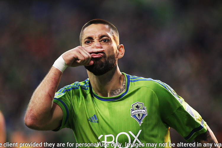 Seattle Sounders teammates ceelbrates with Clint Dempsey after his goal against the Portland Timbers during an MLS match on April 26, 2015 at CenturyLink Field in Seattle, Washington.  Seattle Sounders Clint Dempsey scored a goal to give the Sounders a 1-0 victory over the Timbers. Jim Bryant Photo. ©2015. All Rights Reserved.