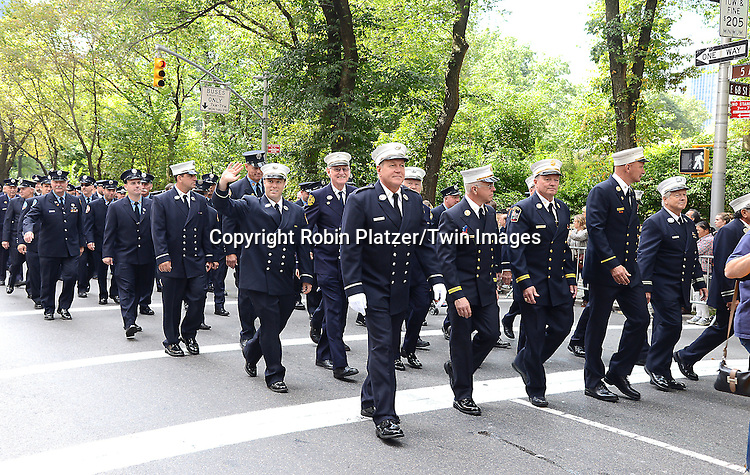 Marchers march in the Steuben Parade on Fifth Avenue in New York City on September 20. 2014.<br /> <br /> photo by Robin Platzer/Twin Images<br />  <br /> phone number 212-935-0770