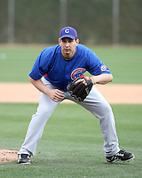 Robert Coello #67 of the Chicago Cubs participates in pitchers fielding practice during spring training workouts at the Cubs complex on February 19, 2011  in Mesa, Arizona. .Photo by Bill Mitchell / Four Seam Images.