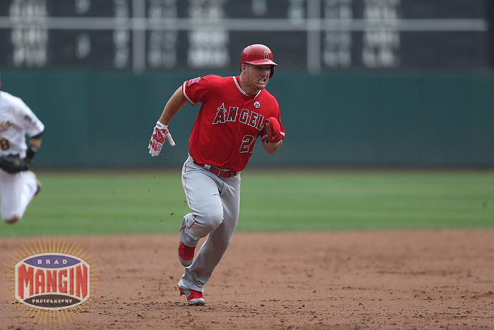 OAKLAND, CA - SEPTEMBER 4:  Mike Trout #27 of the Los Angeles Angels of Anaheim runs the bases against the Oakland Athletics during the game at the Oakland Coliseum on Monday, September 4, 2017 in Oakland, California. (Photo by Brad Mangin)