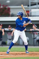 Anderson Miller (12) of the Burlington Royals at bat against the Danville Braves at Burlington Athletic Park on July 12, 2015 in Burlington, North Carolina.  The Royals defeated the Braves 9-3. (Brian Westerholt/Four Seam Images)