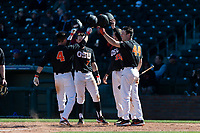Oregon State Beavers shortstop Beau Philip (4) is congratulated by Tyler Malone (7), Adley Rutschman (35), and Alex McGarry (44) after hitting a home run during a game against the Gonzaga Bulldogs on February 16, 2019 at Surprise Stadium in Surprise, Arizona. Oregon State defeated Gonzaga 9-3. (Zachary Lucy/Four Seam Images via AP)