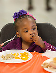 A Sunnyside resident enjoys a Thanksgiving meal served by student volunteers at Worthing High School, November 23, 2013.