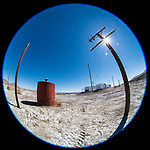 Telephone pole, metal tank converted into a shed along the railroad tracks, Fortymile Desert, Nevada