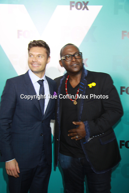 American Idol's Host Ryan Seacrest & Judge Randy Jackson  at The Fox 2012 Programming Presentation on May 14, 2012 at Wollman Rink, Central Park, New York City, New York. (Photo by Sue Coflin/Max Photos) 917-647-8403