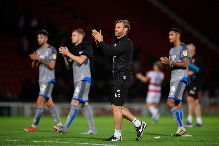 Lincoln City's assistant manager Nicky Cowley applauds the fans at the final whistle<br /> <br /> Photographer Chris Vaughan/CameraSport<br /> <br /> EFL Leasing.com Trophy - Northern Section - Group H - Doncaster Rovers v Lincoln City - Tuesday 3rd September 2019 - Keepmoat Stadium - Doncaster<br />  <br /> World Copyright © 2018 CameraSport. All rights reserved. 43 Linden Ave. Countesthorpe. Leicester. England. LE8 5PG - Tel: +44 (0) 116 277 4147 - admin@camerasport.com - www.camerasport.com
