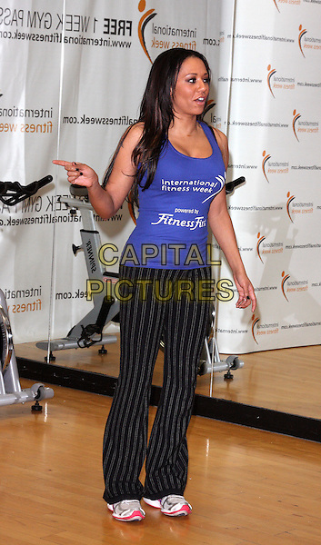 MEL B - MELANIE BROWN.Launches International Fitness Week at Fitness First, Tottenham Court Road, London -  .January 28th, 2010.full length scary spice blue purple tank top black pinstripe trousers joggers trainers sneakers exercise profile hand finger pointing.CAP/ROS.©Steve Ross/Capital Pictures.