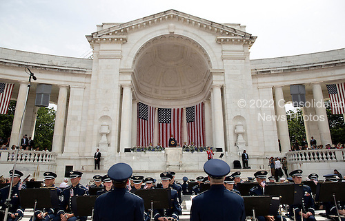 Members of the Air Force band watch as United States President Barack Obama speaks during Memorial Day activities at Arlington National Cemetery in Washington on Monday, May 27, 2013. .Credit: Joshua Roberts / Pool via CNP