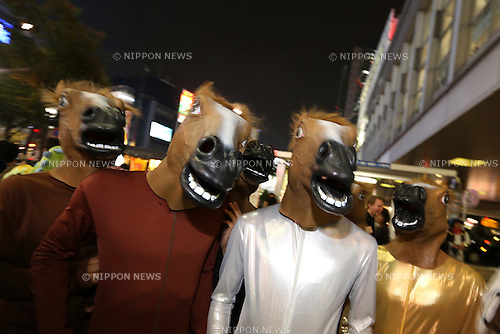 People in costumes walk through Shibuya district on halloween in Tokyo, Japan October 31, 2014.  (Photo by Yuriko Nakao /AFLO)